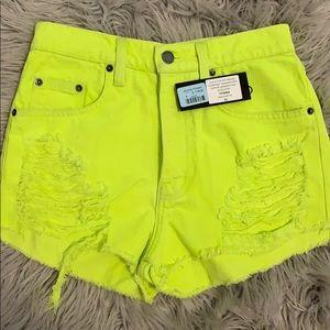 Neon green jean shorts